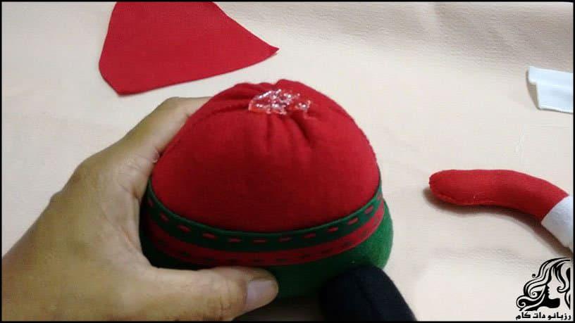 https://up.rozbano.com/view/2934626/Santa%20Claus%20sitting%20Doll-16.jpg