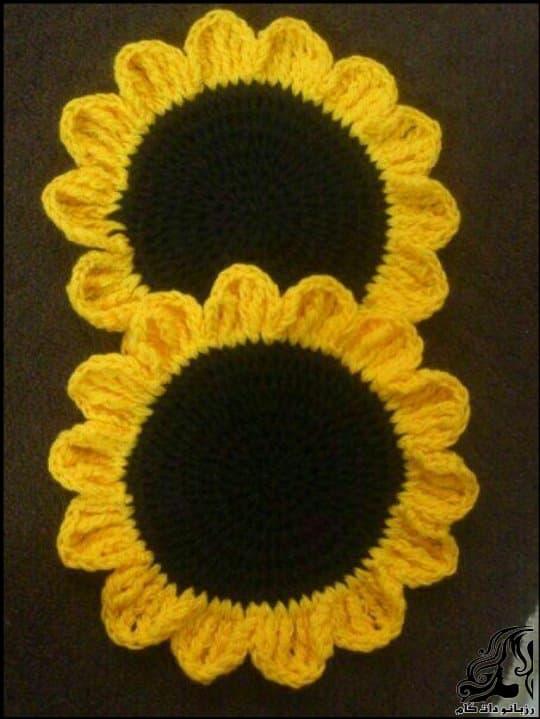 http://up.rozbano.com/view/3112416/Sunflower%20handle%20crocheted.jpg